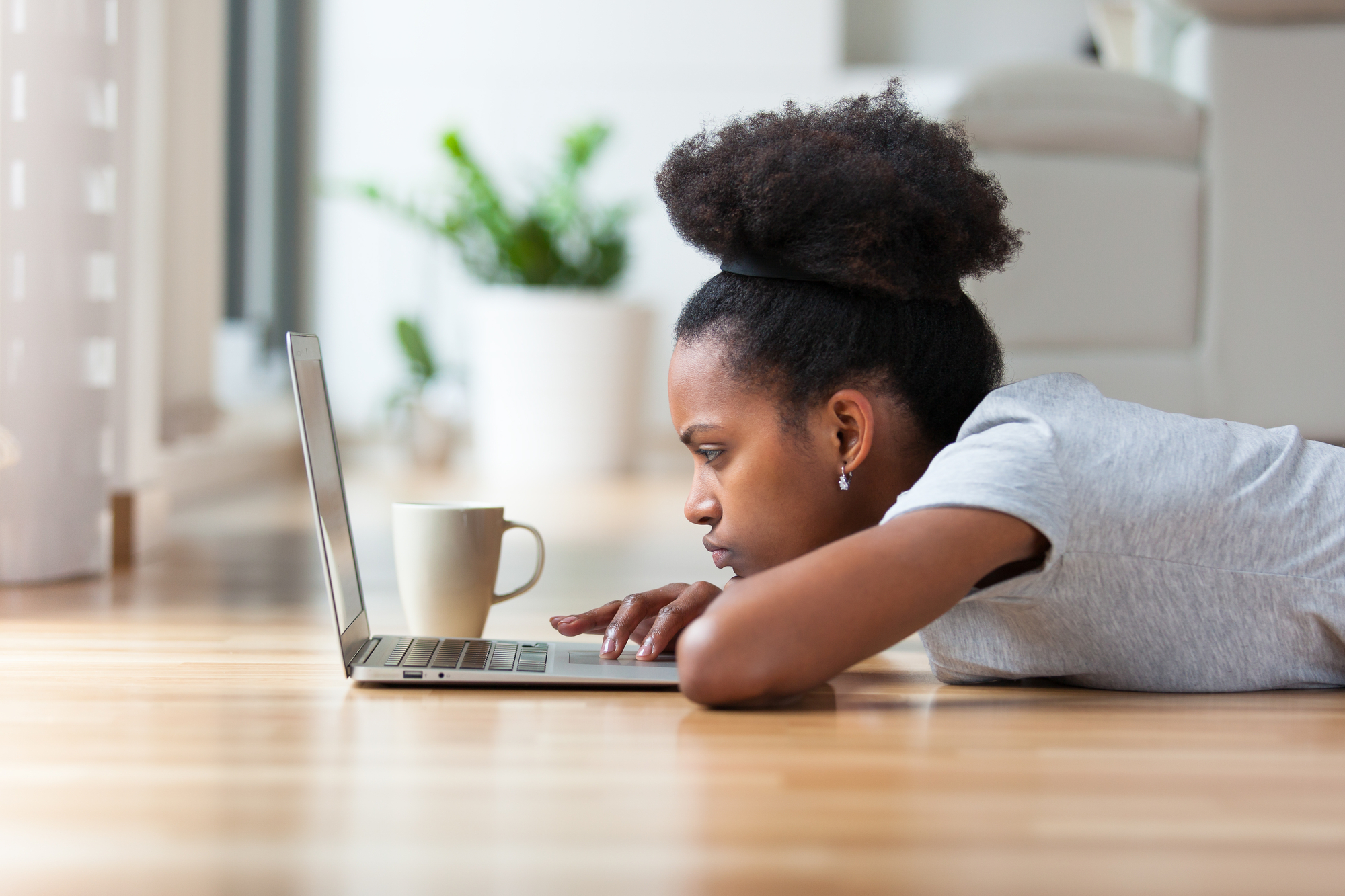 African american woman looks at computer, because website is not working